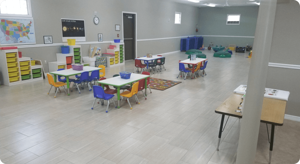 Class room with chairs and many tables