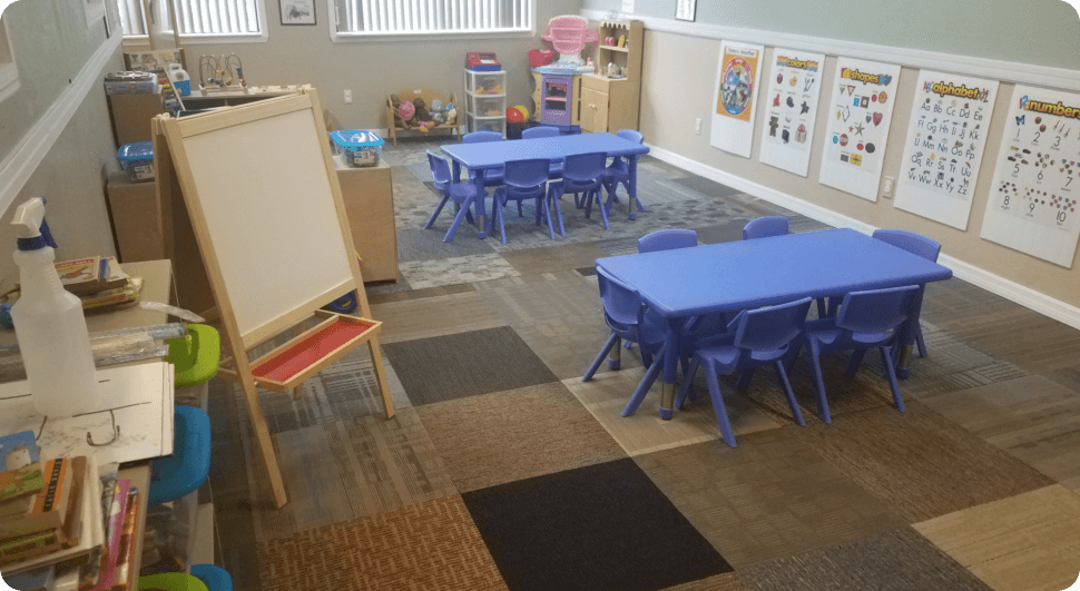 Class room with blue table and chairs