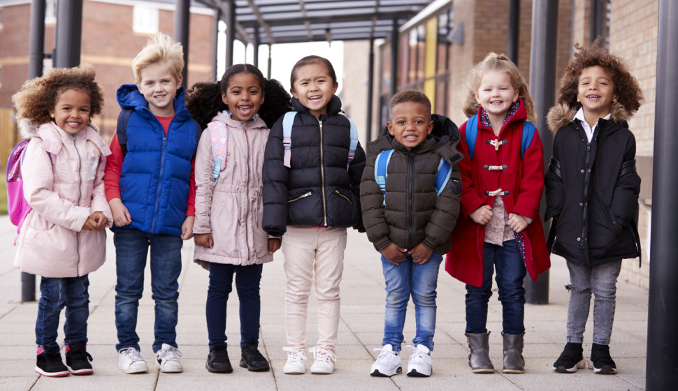 A group of smiling young multi-ethnic school kids