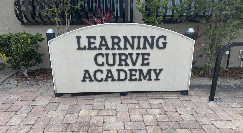 Learning Curve Academy Sign
